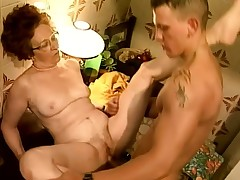 Desirous grandma spreads her legs to have her juicy cooch stretched