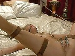 `Riley likes to be dominated, punished and fucked. I tie the young skirt overhead the bed less leather belts, spank her less a paddle and then use metal clamps for her pussy and nipples. She`s ball gag and can`t avow as a consequence of you but she rear e