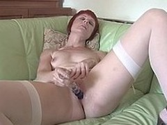 Red housewife playing on her sofa