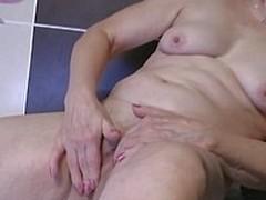 Horny grandma masturbating in the take a bath