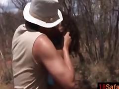 African teen riding sucking white weenie outdoors