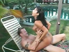 Passionate brunette with big natural boobs fucks a long stick outside