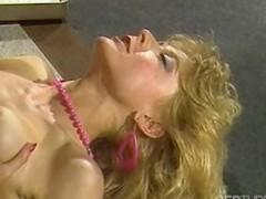 Paradigmatic porn babe Nina Hartley gives her boss a reason to keep her