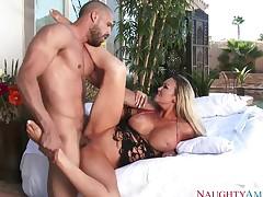 Abbey Brooks gets a visit from her neighbor. He catches her in the garden as she is tanning. Her huge tits are staring at him. He gets a blow job.