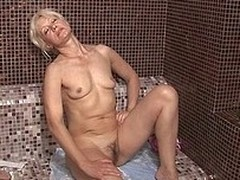 Aged women relaxing in a sauna