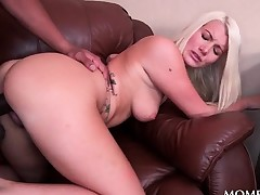 Blonde bents over the sofa for some black cock