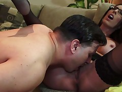 Black haired MILF with glasses Dava Foxx spreads her legs on the sofa and gets her hairy pussy eaten out. Woman in darksome stockings exposes her hot tits as that guy plays with her bush
