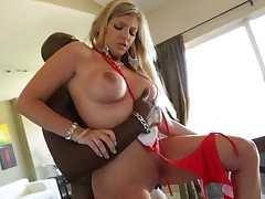 Brianna Brooks is with Lexington Steele and the couple is having interracial sex. The golden-haired is using both her hands to tug a dick. She needs them both to handle it.