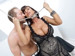 Chained babe Lisa Ann has her big breasts blasted