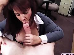 Big tits MILF gives hard cock a titjob
