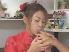 Japanese girls bring off a three way kiss