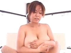 Huge Japanese boobs girl gives titjob