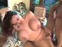 Giant breasted redhead mom bounces on a throbbing prick with passion
