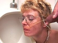 Horny golden-haired aged slut engulfing dick on the WC